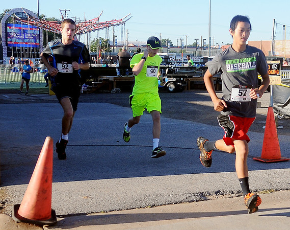 Jonathan Stewart (left) and Joe Keithly (right) lead the 4RKids' 5K run as they leave David Allen Memorial Ballpark Saturday, Sept. 21, 2013. Out of the 92 runners who registered, 88 finished the race. Stewart was the overall male winner with a time of 19.01 minutes and Keithly (right) finished firth in the 14-16 age group. Proceeds from the race benefit children and adults with special needs. (Staff Photo by BONNIE VCULEK)