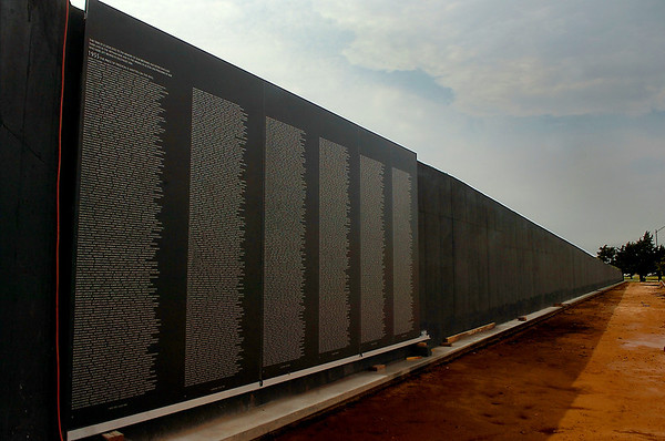 The first panels of the Vietnam Memorial Wall hang in place Monday. The wall is scheduled to be dedicated November 11. (Staff Photo by BILLY HEFTON)