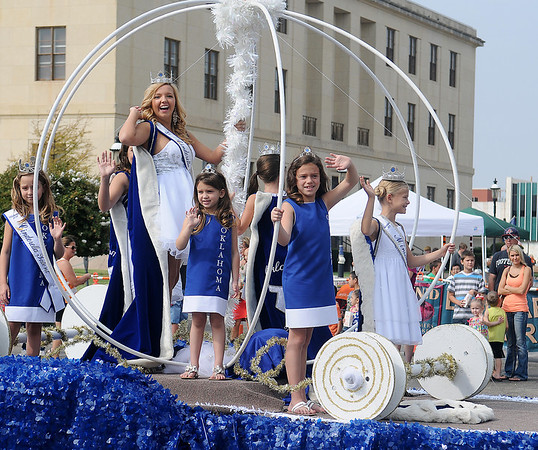 Beautiful young ladies ride the Cinderella Scholarship float during the Cherokee Strip Parade Saturday, Sept. 14, 2013. (Staff Photo by BONNIE VCULEK)