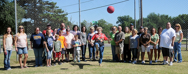 Harrison Elementary School retired teacher, Kay Churchill (center) kicks a ball as alumni return for a reunion and tour of their old school Saturday Sept. 21, 2013. The group met for breakfast at Wee Too, toured the school, played familiar games from their childhood and then had lunch at Meadowlake Park. (Staff Photo by BONNIE VCULEK)