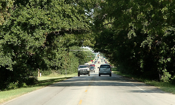 Traffic flows along west Willow Tuesday between Cleveland and Oakwood streets. The Enid city commission voted to begin condemnation proceeding on a property to clear the way for the widening of Willow between Cleveland and Oakwood. (Staff Photo by BILLY HEFTON)