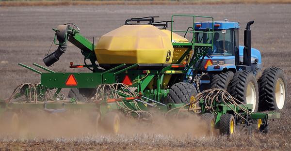 An area farmer prepares his acreage for planting wheat Thursday, Sept. 26, 2013. (Staff Photo by BONNIE VCULEK)