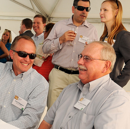 Curt Roggow and Dr. James Strate relax before Enel Green Power North America's Chisholm View Wind Project dedication and ribbon cutting in Hunter Wednesday, Sept. 11, 2013. (Staff Photo by BONNIE VCULEK)
