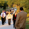 Dignitaries and guests walk toward the bridge that connects NWOSU and NOC prior to the dedication Thursday, Sept. 26, 2013. The bridge and trail are symbolic of the commitment that both colleges have made to assist students with their concurrent higher education opportunities in Enid. (Staff Photo by BONNIE VCULEK)