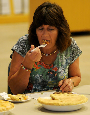 Martha Gabriel (right), a former Extension Home Economist, tastes an apple pie as she judges the pie category during the Garfield County Fair Friday, Sept. 6, 2013. (Staff Photo by BONNIE VCULEK)