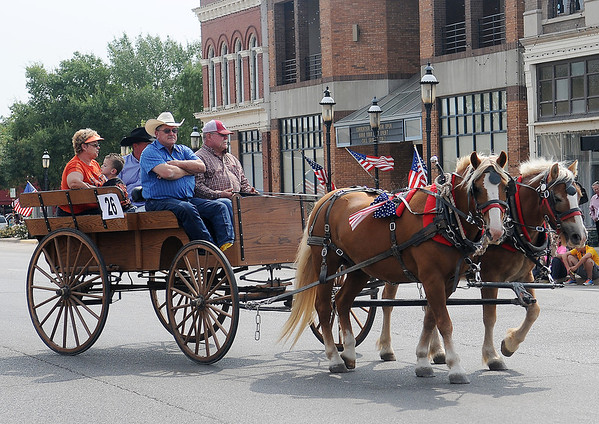A horse-drawn wagon turns onto W. Maine during the Cherokee Strip Parade Saturday, Sept. 14, 2013. (Staff Photo by BONNIE VCULEK)