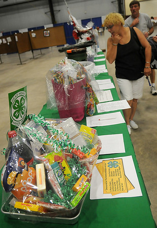Individuals place bids on the Garfield County 4-H silent auction baskets at the Garfield County Free Fair Saturday, Sept. 7, 2013. (Staff Photo by BONNIE VCULEK)