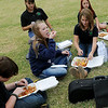 Emerson Middle School orchestra members enjoy and Indian Taco after performing during the Cherokee Strip Celebration festivities on the Garfield County Court House lawn Friday, Sept. 13, 2013. (Staff Photo by BONNIE VCULEK)