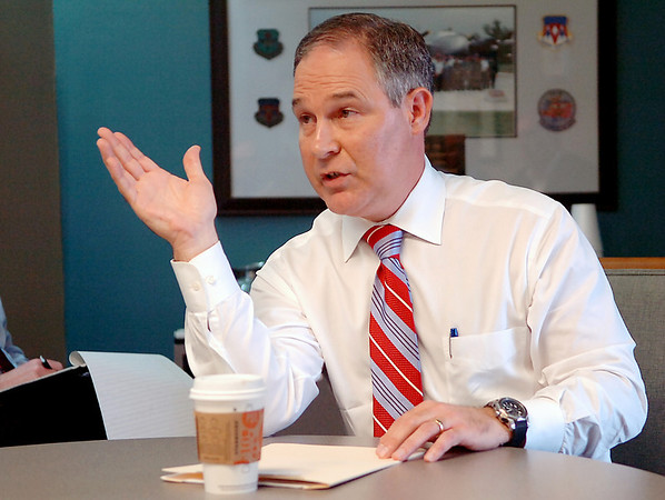 Oklahoma attorney general, Scott Pruitt, gestures as he talks to an informal gathering of business leaders at the Enid Chamber of Commerce office Tuesday. (Staff Photo by BILLY HEFTON)