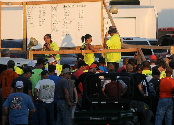 Drivers attend a meeting prior to racing action at the Enid Speedway Saturday, Sept. 7, 2013. (Staff Photo by BONNIE VCULEK)