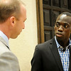 American Olympian Lopez Lomong visits with Aaron Brownlee during the Wymer Brownlee community luncheon at the NOC-Enid Gantz Center Friday, Sept. 13, 2013. (Staff Photo by BONNIE VCULEK)