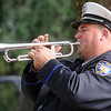 """Enid Police Officer Lee Frisendahl plays """"Taps"""" during the service for fellow officer, Sgt. Richard Allan """"Rick"""" Tanner, II, at Memorial Park Cemetery Saturday, Sept. 14, 2013. (Staff Photo by BONNIE VCULEK)"""