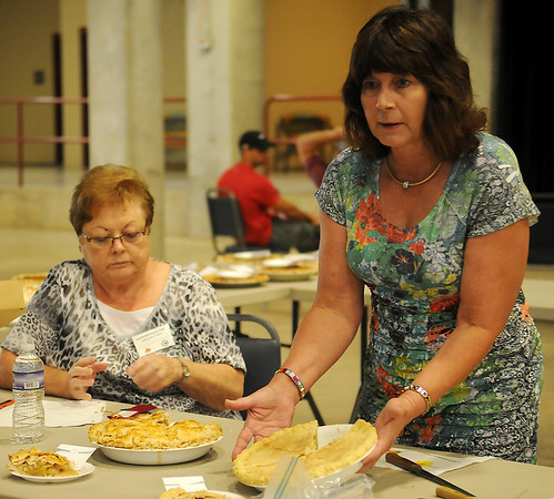 Martha Gabriel (right), a former Extension Home Economist, explains the differences between the first place apple pie entry and second during pie judging at the Garfield County Fair Friday, Sept. 6, 2013. (Staff Photo by BONNIE VCULEK)
