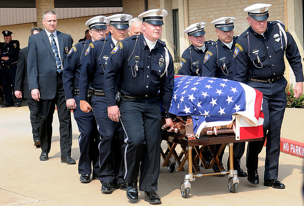"""The Enid Police Department Honor Guard escorts the remains of their fallen comrade, Sgt. Richard Allan """"Rick"""" Tanner, II, to a waiting vehicle following a ceremony at Oakwood Christian Church Saturday, Sept. 14, 2013. (Staff Photo by BONNIE VCULEK)"""