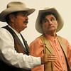 Larry and Rick Simpson, owners of Simpson's Old Time Museum, discuss the Great Land Run of 1893, staking a claim, food and shelter for the early Oklahoma settlers, and the Chisholm Trail during a presentation to 6th and 7th grade history classes at Emerson Middle School Thursday, Sept. 12, 2013. Monday, Sept. 16 marks the 120th anniversary of the Run of 1893. (Staff Photo by BONNIE VCULEK)