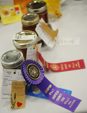 Sally Clickner's pineapple salsa won the HCE-Food Preservation champion ribbon during the Garfield County Free Fair at the Chisholm Trail Coliseum Saturday, Sept. 7, 2013. Clickner had not entered the category before taking a special canning workshop. (Staff Photo by BONNIE VCULEK)