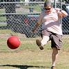 Dawn Smith kicks the ball during a Harrison Elementary School alumni game Saturday, Sept. 21, 2013. (Staff Photo by BONNIE VCULEK)