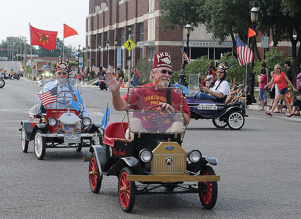 Members of the Enid Shrine Club entertain the Cherokee Strip Celebration crowd along the parade route in downtown Enid Saturday, Sept. 14, 2013. (Staff Photo by BONNIE VCULEK)