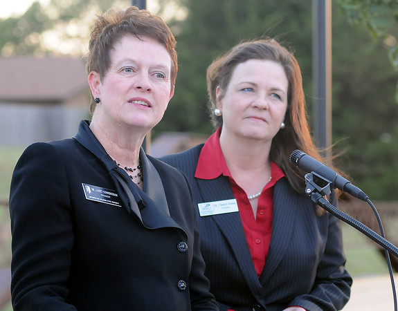 Dr. Janet Cunningham, President of Northwestern Oklahoma State University, and Dr. Cheryl Evans, President of Northern Oklahoma College, express their gratitude to the businesses, dignitaries, students and guests that support the two higher-education programs in Enid during the NOC/NWOSU Bridge and Trail dedication Thursday, Sept. 26, 2013. The bridge and trail are symbolic of the commitment that both colleges have made to assist students with their concurrent higher education opportunities in Enid. (Staff Photo by BONNIE VCULEK)