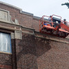 Workers remove and replace mortar on the exterior of Emerson Middle School Thursday, Sept. 11, 2013. (Staff Photo by BONNIE VCULEK)