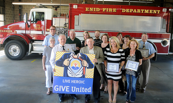 Several United Way pacesetters gather on the apparatus floor at the Enid Fire Department Central Station after their businesses and organizations made a generous donation to this year's 1.15 million dollar goal Thursday, Sept. 26, 2013. To date, 24 different sponsors have contributed at least $100,000. (Staff Photo by BONNIE VCULEK)