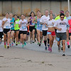 Hiland Partners Great Land Run participants finish the first section of the 5K race on E. Maine and make the turn toward St. Mary's Regional Medical Center Saturday, Sept. 14, 2013. More than 350 registered for the Cherokee Strip Celebration event, with proceeds providing technology for Enid Public Schools. (Staff Photo by BONNIE VCULEK)