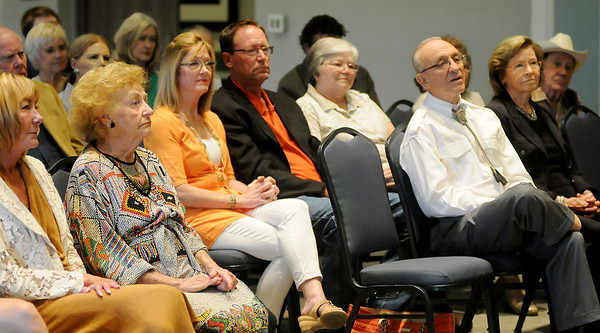 Guests listen as Mike Stuber reads the 2013 Enid Walk of Fame proclamations from Enid Mayor Bill Shewey at Convention Hall. Delores McClure (second, from left) accepted the award for her late husband, Larry. Lynn Henneke (center) was present to receive the honor for her father, Lew Meibergen, and Lew Ward (front right) was the third recipient of the distinguished honor. (Staff Photo by BONNIE VCULEK)