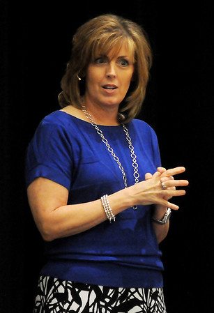 Carol Sallee addresses more than 400, seventh grade girls at the character based abstinence event, Guard Your Heart Girls Tea, in the Convention Hall grand ballroom Wednesday, Sept. 11, 2013. (Staff Photo by BONNIE VCULEK)