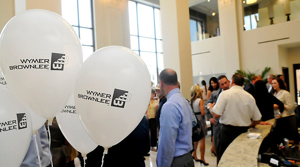 Wymer Brownlee held an open house Thursday for their new facility at what used to be One Grand Center. (Staff Photo by BILLY HEFTON)