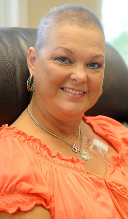 Susanne Lee receives a cancer treatment at Dexeus Oncology Wednesday, Sept. 25, 2013. (Staff Photo by BONNIE VCULEK)