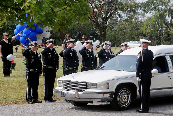 """The Enid Police Department Honor Guard salutes as the hearse carrying fellow police officer, Sgt. Richard Allan """"Rick"""" Tanner, II, arrives at Memorial Park Cemetery Saturday, Sept. 14, 2013. (Staff Photo by BONNIE VCULEK)"""