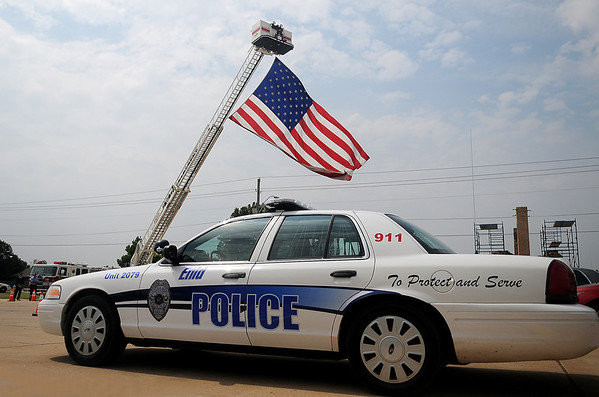 """A large American flag flies over the driveway entrance to Oakwood Christian Church as Enid Police Officers gather for the funeral service for Sgt. Richard Allan """"Rick"""" Tanner, II, Saturday, Sept. 14, 2013. (Staff Photo by BONNIE VCULEK)"""