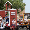 Children from St. Joseph Catholic School portray a scene from an early one room school house during the Cherokee Strip Parade Saturday, Sept. 14, 2013. (Staff Photo by BONNIE VCULEK)