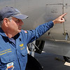 Dave Gross, a member of the B-17 C and B-25 J flight crew for the Commemorative Air Force Arizona Wing, points to one of six repaired bullet holes in the hull of the World War II Combat Veteran aircraft Monday, Sept. 23, 2013. The restored, historic plane, which flew 15 missions with the 57th Bomb Wing 391st Bomb Group 437th Squadron, will remain on display throughout the week at Enid Woodring Regional Airport. (Staff Photo by BONNIE VCULEK)