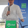 Brent Kisling, from the Enid Regional Development Alliance, addresses guests during Enel Green Power North America's Chisholm View Wind Project dedication and ribbon cutting in Hunter Wednesday, Sept. 11, 2013. (Staff Photo by BONNIE VCULEK)