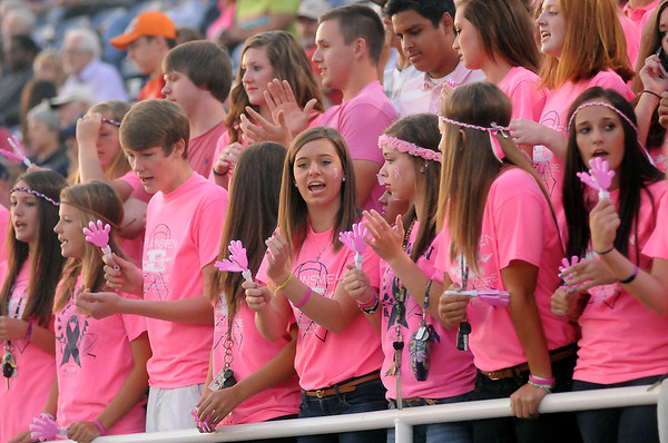 Enid High School students cheer for the Plainsmen during Win-Win football action Friday, Sept. 20, 2013. (Staff Photo by BONNIE VCULEK)