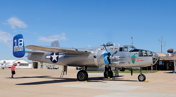 A gentleman (lower left) tours the Maid in the Shade B-25 J World War II Combat Veteran at Enid Woodring Regional Airport Monday, Sept. 23, 2013. The aircraft flew 15 missions with the 57th Bomb Wing, 391 Bomb Group with the 437th Squadron. The Commemorative Air Force Arizona Wing Ghost Squadron assisted with the bomber's restoration and travels with the aircraft. (Staff Photo by BONNIE VCULEK)
