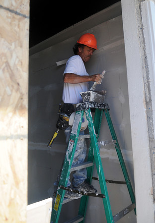 Ray Followill remodels the interior of the new Universal Maintenance location at the corner of Randolph and Van Buren. The building was formerly Cheezie's Pizza. (Staff Photo by BONNIE VCULEK)