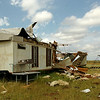 A trailer house, 1.75 miles east of U.S. 81 on Flynn Road was severely damaged during a thunderstorm's downburst south of Waukomis in Garfield County Monday, Sept. 1, 2014. A large metal building and the front porch of the Collins Farm home on Flynn Road were also damaged. (Staff Photo by BONNIE VCULEK)