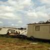 A trailer house and a large metal building, 1.75 miles east of U.S. 81 on Flynn Road were severely damaged during a thunderstorm's downburst south of Waukomis in Garfield County Monday, Sept. 1, 2014. A large metal building and the front porch of the Collins Farm home on Flynn Road were also damaged. (Staff Photo by BONNIE VCULEK)