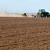 A farmer plants a field near Carrier Monday. (Staff Photo by BILLY HEFTON)