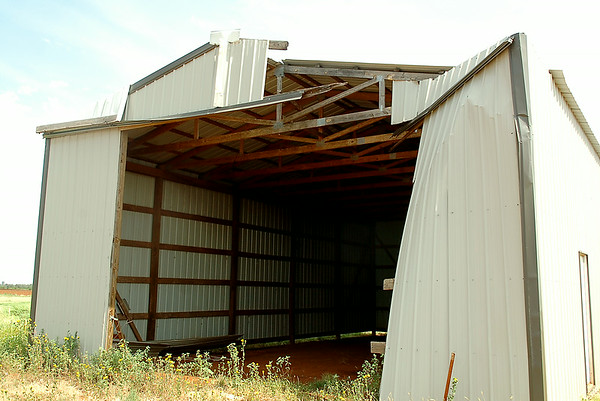 A large metal building on Flynn Road, southeast of Waukomis, sustained damage during a thunderstorm's downburst as winds gusting to 70 mph, large hail and heavy rain moved across Garfield County Monday, Sept. 1, 2014. (Staff Photo by BONNIE VCULEK)
