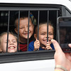 Madison Blom, Noah Webb and Kelcy Blom have their picture taken in the back of an Enid Police Department squad car Saturday September 24, 2016 during the Yellowhouse Motor Mania event at Leonardo's Children's Museum. (Billy Hefton / Enid News & Eagle)