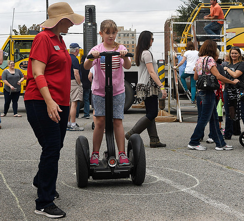 Brittany Southwell rides a segway as Heather Newman guides her through a course Saturday September 24, 2016 during the Yellowhouse Motor Mania event at Leonardo's Children's Museum. (Billy Hefton / Enid News & Eagle)