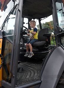 Logan Thompson sits at the controls of a backhoe Saturday September 24, 2016 during the Yellowhouse Motor Mania event at Leonardo's Children's Museum. (Billy Hefton / Enid News & Eagle)