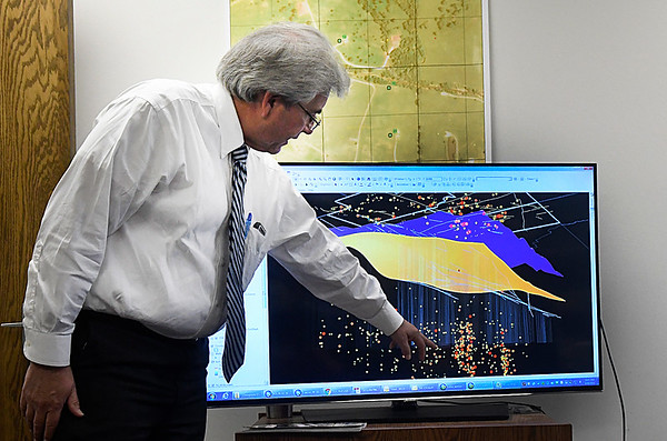 Matt Skinner, spokesman for the Oklahoma Corparation Commission, point out some of the feaures in the new technology being used to track earthquakes during an interview Wednesday September 14, 2016 in Oklahoma City. (Billy Hefton / Enid News & Eagle)