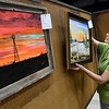 Karen Schimon hangs painting for the Fine Arts exhibit Wednesday September 7, 2016 for the Garfield County  Fair at the Chisholm Trail Expo Center. (Billy Hefton / Enid News & Eagle)