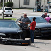 Enid police officers collect information at the scene of an accident at the intersection of Van Buren and Pine Tuesday September 5, 2017. (Billy Hefton / Enid News & Eagle)
