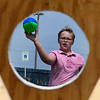 Kamden Belter takes part in the football toss following the 4 RKids Walk Saturday September 9, 2017 at Meadowlake Park. (Billy Hefton / Enid News & Eagle)
