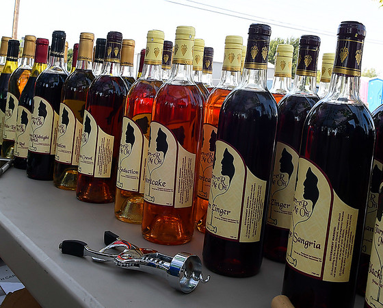 A table full of wine at the Hennessey Wine and Chocolate Festival Saturday September 9, 2017. (Billy Hefton / Enid News & Eagle)